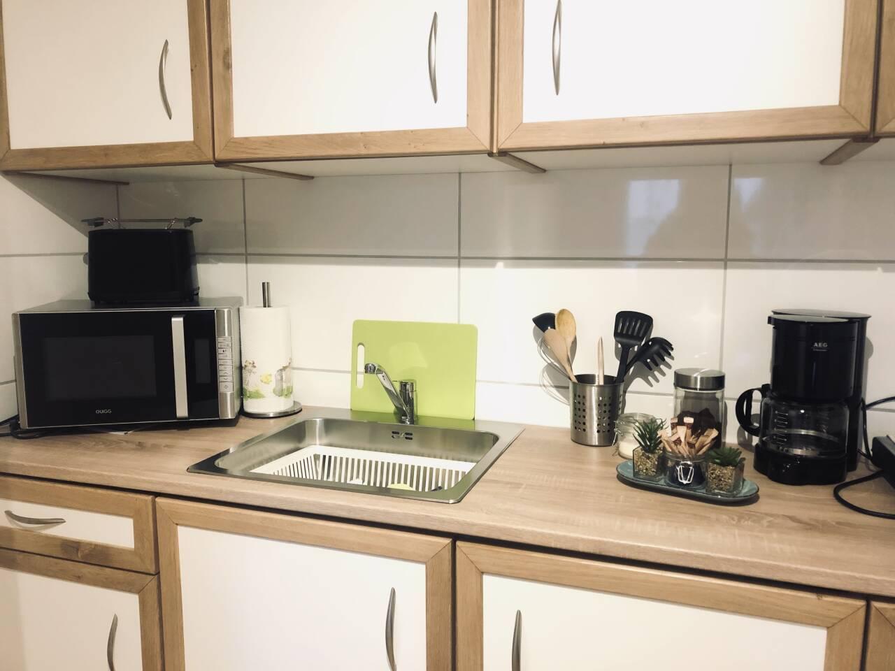 Zimmer Ausstattung Küchenzeile in ihrer FeWo direkt Unterkunft